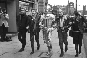 Punks and a Cyberman walk along Lothian Road, Edinburgh, helping to publicise a Dr Who exhibition in 1983